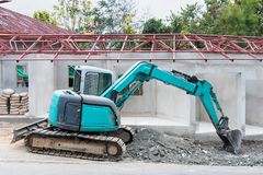 Green digger at the construction site.Thailand. Green digger at the construction site.Thailand Royalty Free Stock Photo