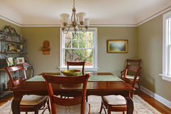 Green dining room with mahogany furniture Stock Photography
