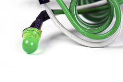 Green  diod  isolated on white. Green diode on helical conductors are isolated on white Stock Images