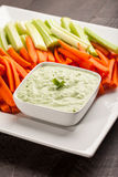 Green dip with carrots and celery. Creamy radish kale green dip with carrots and celery Royalty Free Stock Photo