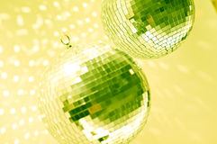 Green disco globes. Green mirror discos globe reflecting light Royalty Free Stock Images
