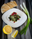 Green dish called خبيزة  khobbeizeh. Natural winter green leaves cooked as a famous middle eastern dish called khobbeizeh Royalty Free Stock Photos