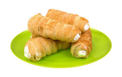 Green dish with cream horns Stock Photography