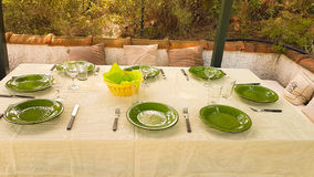 Green dishes on table ready for food to be served on a formal lunch time. Stock Photo