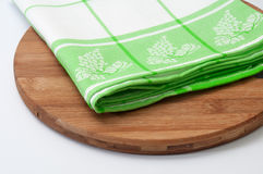 Green dishtowel on a kitchen wooden dasic Royalty Free Stock Photography