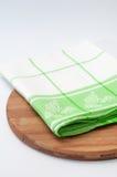 Green dishtowel on a kitchen wooden dasic Stock Photo