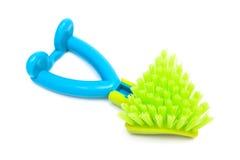 Green dishwashing brush Stock Photos