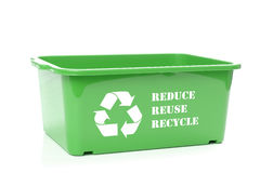 Green disposal container. Green plastic disposal container with white recycle symbol  and reduce-reuse-recycle text - over white background Stock Image