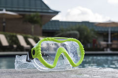 Green diving goggles by the pool Royalty Free Stock Photography