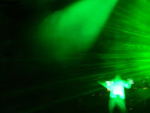 Green DJ atmosphere. DJ stage. Green atmosphere with a green laser moving stock photography