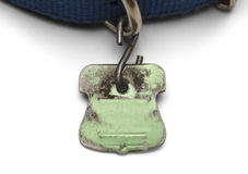 Green Dog Tag. Blank Pet Dog Tag Shield Worn out and Scratched Isolated on White Background Royalty Free Stock Images