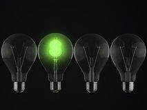 Green dollar sign illuminated. In row of light bulbs against black background Royalty Free Stock Photos