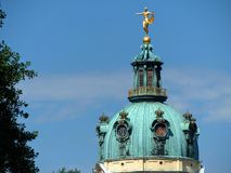 Green dome of the Charlottenburg castel of Berlin with a golden statue on the top, Germany. stock image