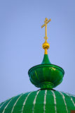 Green dome and gold cross Royalty Free Stock Photography