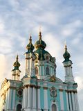 Green domes of the church with gold ornaments. royalty free stock photo