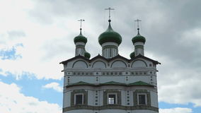 Green domes with crosses of an Orthodox monastery. On the background of blue sky and floating clouds stock video footage