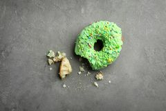 Green donut with sprinkles. On grey background Royalty Free Stock Photos