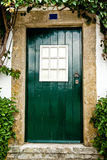Green door in Óbidos Stock Images