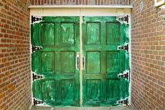 Green Door. Hand painted in green color grunge garage door Stock Photos