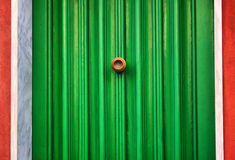 Green door. Photo of facade oh red house with green door royalty free stock images
