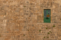 Green door. Green balcony door and a stone wall royalty free stock images