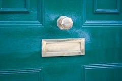 Green door. Closeup of a blue door of a traditional UK house Stock Image
