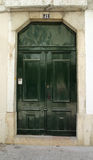 Green door. Old green door in Lisbon, Portugal Royalty Free Stock Photos