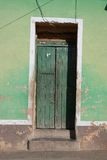 Green door. A green house door in Trinidad, Cuba stock images