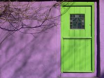 Green Door. A green door on a purple painted house in Ireland Royalty Free Stock Photos