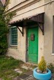 Green door abandoned Stock Photo