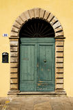 Green Door with Arch in a Yellow Wall, Italy Stock Photography