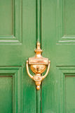 Green door with brass knocker Royalty Free Stock Image