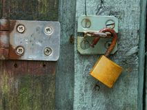 Green door brass lock steel hasp Stock Images