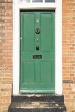 Green Door in a Brick Building Royalty Free Stock Photo