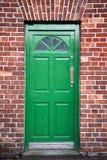 Green Door. In a brick building in Ireland Royalty Free Stock Images