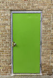 Green door on brick wall Royalty Free Stock Photos