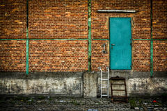 Green door on brick wall Stock Photos
