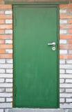 Green door in brick wall Stock Photography