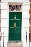 Green door, colour home building Royalty Free Stock Photo