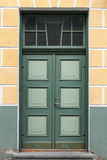 Green door with decoration elements Royalty Free Stock Photos