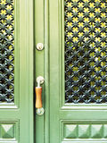 Green door with decorative grid Royalty Free Stock Photo