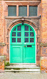 Green door. A green double arched door in a red brick building in the UK Royalty Free Stock Photography