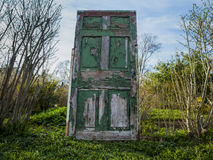 The Green Door. A green door found in the middle of nowhere Royalty Free Stock Image