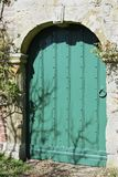 Green door in garden wall Royalty Free Stock Photos