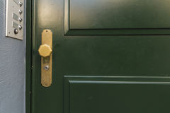 Green door with golden knob Royalty Free Stock Photo