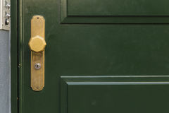 Green door with golden knob Royalty Free Stock Photography