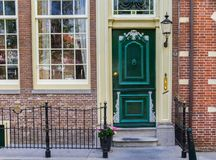 Green door of a historic house in Edam Stock Photography