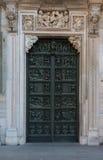Green Door 1. Intricate green door set within white frame masonary detailed stone Stock Image