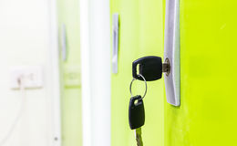 Green door with keys in lock Royalty Free Stock Photo