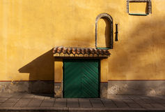 Green door mustard wall Royalty Free Stock Photo